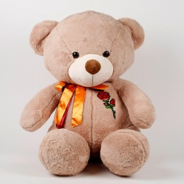 Brown teddy soft toy