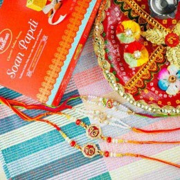 Four Devine Rakhi Set With Soan Papdi and Pooja Thali