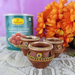 Couple Of Gulab Jamun N Diyas