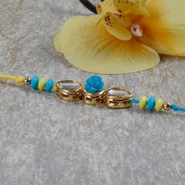 Yellow And Blue Embellished Rakhi