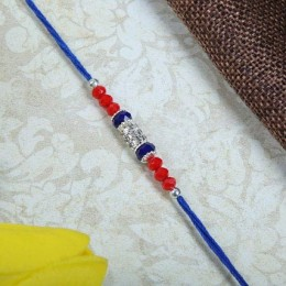 American Dianon with Blue Rakhi thread