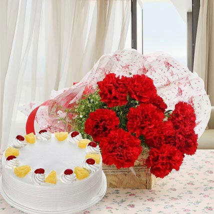 Red Carnations And Eggless Pineapple Cake
