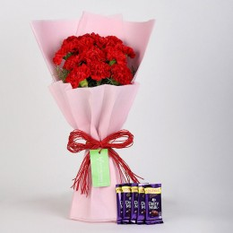 12 Beautiful Red Carnations & Cadbury Dairy Milk