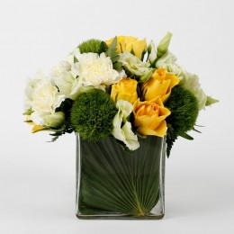 Yellow Roses White Carnations in Glass Vase
