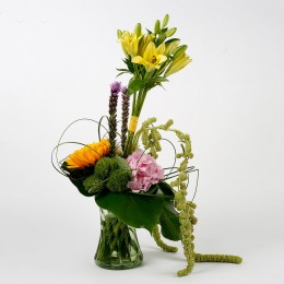 Imported Roses Lilies Liatries in Glass Vase Arrangement