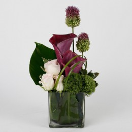 Purple Calla Lilies Pink Roses in Glass Vase